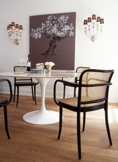 Classic armed bentwood chair seen here with another classic - the tulip table