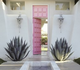 Unique entrance with soft pink door