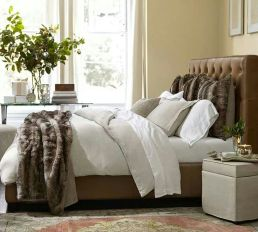 Just looking at the picture of this bed with it's fur throw and cushions makes you feel warm and cozy