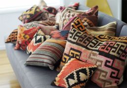 A great way to add global infusion to any room with these colorful toss cushions