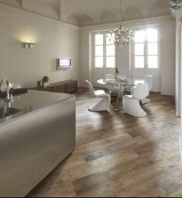 Angled large distressed wood plank flooring.