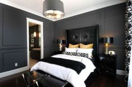 contemporary bedroom black walls with gold accents