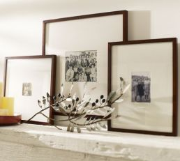 Photo frames on fireplace mantle