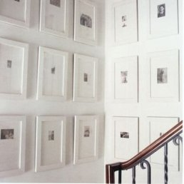 Photo frames with large mats on stairway