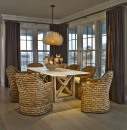 Thick rafia rope chairs in neutral Coastal dining room