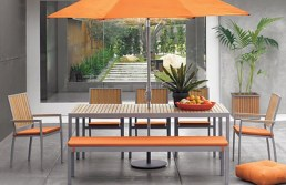 Teak and aluminum modern dining set.