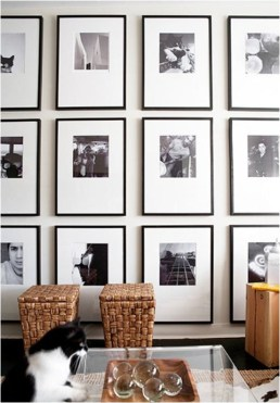 Dark frames with large white mats with black and white photography