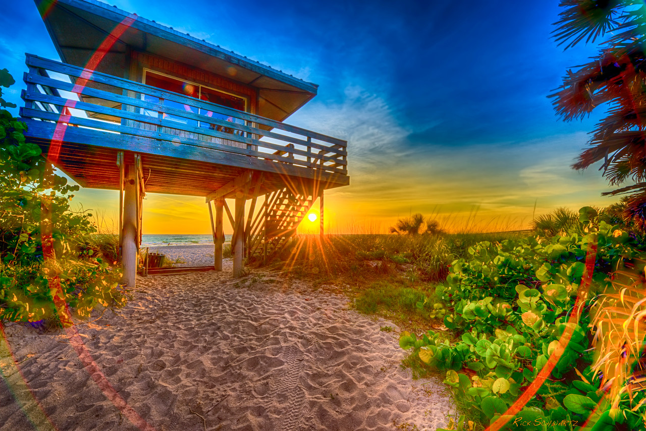 This is the lifeguard lookout stand in Nokomis Florida. When I came upon this I noticed a gentleman sitting on the stairs in quiet contemplation. I'm pretty self conscious so I did my best not to make too much noise while taking this picture. The clicks on my camera can be a little annoying, so after I got the shot I quickly moved on to leave the soul in peace.