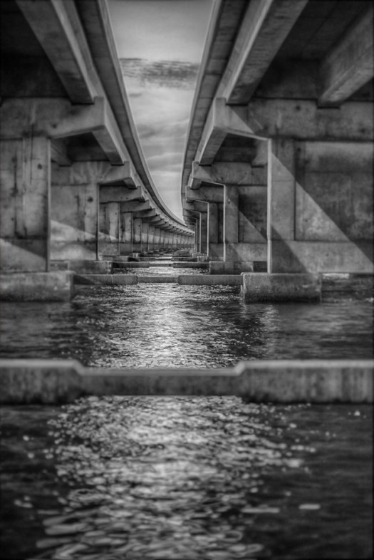 So this might not look familiar but it's under the Sunshine Skyway bridge between Tampa Bay and the Gulf of Mexico. Sometimes I find myself in the craziest places in search of a shot, especially when not traveling. When I do travel I cross this bridge in a car on my way to the airport at a pretty good rate of speed. The bridge is so level and smooth I forget I'm traveling over a vast body of water with dolphins, sharks and swift currents below. Before this was built the old one collapsed and a bus and cars just drove right off the bridge into the water. Yeah I know, scary. But today I doubt anything like that will happen again, this bridge is constantly under maintenance, no chances are being taken. And thanks to all that maintenance its a very smooth ride and I forget I'm driving over the Gulf of Mexico. Thankfully though, the state of Florida does not.