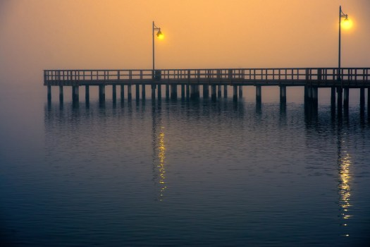 his fishing pier is along the Riverwalk in Bradenton Florida. I liked how the thick fog diffused the morning sun. As a photographer I'm attuned to variations in light all around me. It's interesting because the more I mentioned it, more people around me notice it as well. My wife is now pointing out potential sunsets hours before they happen and even my trainer mentioned the light as it cast a glow into the gym the other morning. I think that's cool, and of course, a very simple pleasure indeed.
