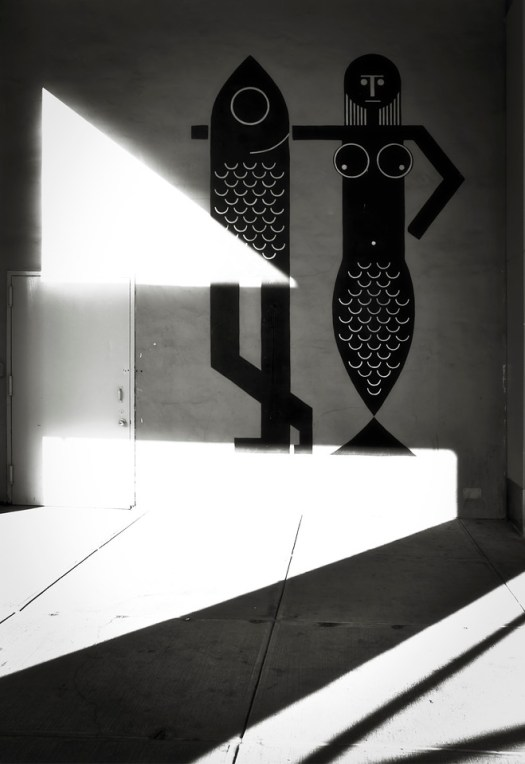 I passed this wall art in lower Manhattan and thought the shadows added a different dimension to the art. That's the thing about street art, the environment plays a role in the telling of the story. In this case, at least for me, the shadows and light transformed the art into something completely new. How cool is that?