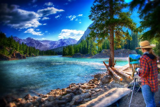 I'm sure there is a name for this, a photo of a scene of an artist painting a scene. If nothing else it's circular in reference and something that would drive someone like me mad, but this is art, or photography, ...or something else, so no madness today. I was in Banff Alberta along the Bow River when I captured this. That was in summer and I imagine now that winter has hit it looks a little different, perhaps a bit more white in the  frame. I like to call what I do Photo Art because in a way I paint with light. My pallet is the of light of various apertures, yet it's a pallet nonetheless. I could go on but you get the idea. New forms of art, new mediums. Thank you unknown artist, from you I draw inspiration.