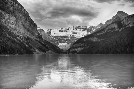 If I had this view out back I'd never leave home. Nonetheless, this is the view you see from the Chateau Lake Louise in Alberta Canada. The last time I was here the lake was frozen and I was with a climbing party where we scaled a frozen waterfall towards the back on the right. It was an all day affair and since I was not qualified to lead I stayed below as the lead climber secured a route up the fall. If you can imagine being chained to a rock in subzero temperatures followed by brief periods of adrenalin rush, that would pretty much summed it up. Aside from that, my other memory is of how good the peppermint schnapps tasted once we finished. Our party must have been quite a site as we walked into the five-start hotel outfitted with ice axes, crampons and all manner of climbing gear. In fact, it was probably a common sight as this is a popular winter sport destination. Anyway, back to the present day. Winter or summer, the view here is about as good as it gets.
