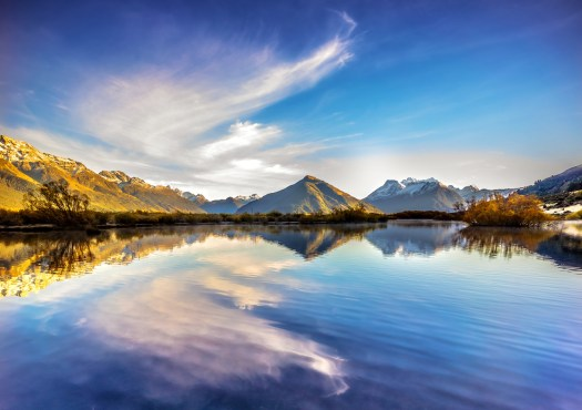 Glenorchy in New Zealand on a brisk morning. Glenorchy is about an hour drive north of Queenstown, is surrounded by mountains on all sides, and is at the northern end of Lake Wakatipu which is a very long lake. This shot is looking towards Mount Earnslaw which is prominent in the area. With all this at every turn I could understand why the people of New Zealand seem to have an outdoors lifestyle. Being surrounded as such they seem generally happy and healthy. Of course it's hard to generalize, but that was the impression I was left with, and I think it's not far off the mark. I had an overwhelming desire to explore every stop we made. I'm pretty sure I'd still be there hiking through the hills and valleys if I stopped at each vista we came across. And who knows, I might even be a little healthier.
