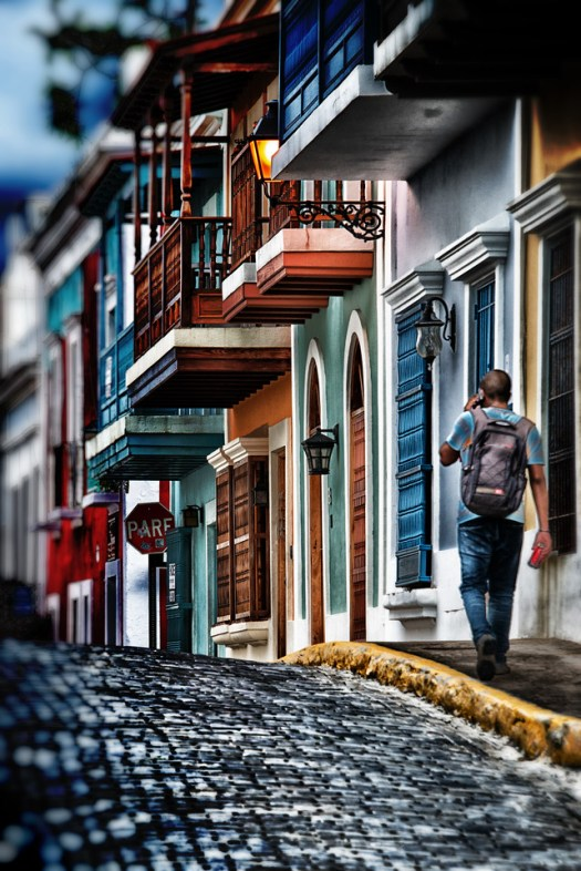This is the old town section of San Juan, Puerto Rico. Walking through here on a recent afternoon was like walking back in time to a different era. It seems time has slowed down here and a different pace of life is respected. People get together for conversation and gatherings in the streets or in verandas above. This colorful street was just one of many I passed and to me represents a feeling of community and charm rarely found today. I will return to Puerto Rico one day and when I do I'll stay a little longer, and move a little slower.