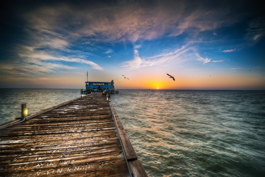I took this shot at sunrise quite a few months ago not knowing that shortly after there would be a fire here. This is the Rod and Reel which is at the end of it's own pier on Anna Maria Island in Florida. There is no question they have the best Grouper sandwiches around, not to mention the best scenery. It's currently being rebuilt and I think they're getting close to re-opening. I for one have been in Rod and Reel withdrawals and can't wait to get back here for an afternoon of just kicking back to the best Florida has to offer.