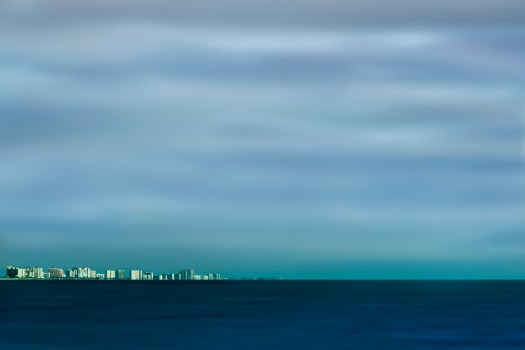 This is a shot of the Florida beach town of Clearwater taken from Honeymoon Island State Park. This is a long exposure that I took from a breakwater that jetted out into the gulf.  Normally when you are in Clearwater there is a lot going on, so much to see and do. But from here, a distance of about eight miles, everything seemed so peaceful and calm.