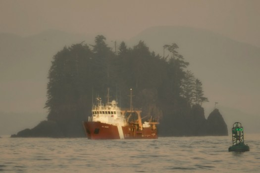 A Canadian coast guard cutter makes its way back to port in Ucluelet British Columbia.