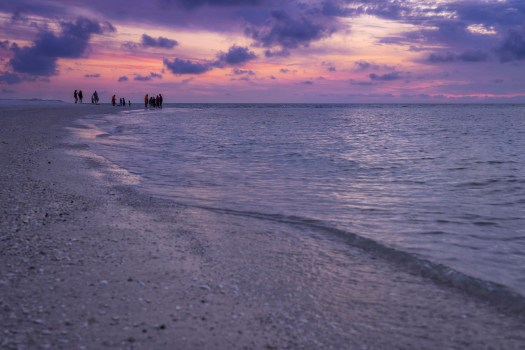 This is at the very tip end of Anna Maria Island locally known as Bean Point. My wife and I came here last night to catch the sunset and take a few photos. We lingered until dark, relishing every last bit of the pastel hues and warm water until we knew we must go. On our way out we stopped at the local ice cream shop and to our surprise there was a line out the door. I thought to myself, what an iconic little village, and what better way to enjoy a Sunday evening than watch the sunset and stop for ice cream on the way home.