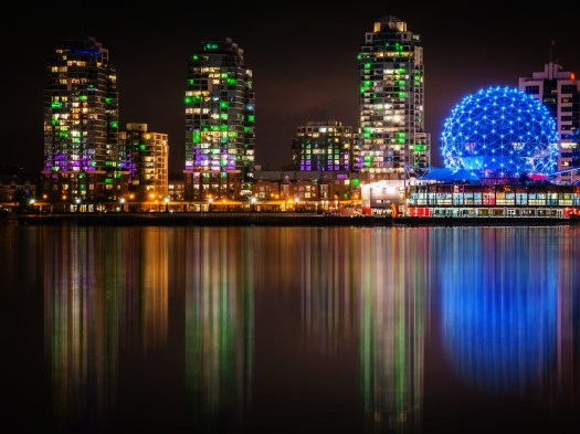 I was walking around Vancouver a few weeks ago and spotted these buildings along False Creek. I'm guessing the green lights were for St. Patricks day. The building on the right is the Telus Science Center. When I left just over a week ago the Cherry Blossoms were just coming out so I imaging they're in full bloom now. From a sensory perspective, this city is visual overload, and that's a good thing. ;-)