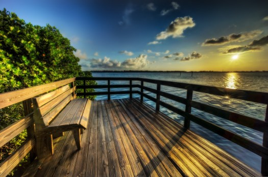 This bench is at Leffis Key which is one of the places I like to walk around with my camera. It's mostly mangroves and you can walk on elevated wooden walkways all over. Every now and then you end in a vista of the water with a little bench like this. If you get here first thing in the morning you'll see the Pelicans flying by as they go about their morning fishing routine. I like since the water is so calm and all of the wildlife is up and about. You could just sit here and take it all in, which I've been known to do on occasion.