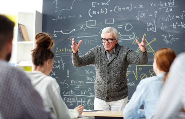 Excited teacher looking at group of students while explaining his subject