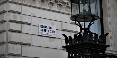 Downing Street road sign on side of building