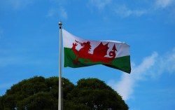 Welsh flag with blue sky background
