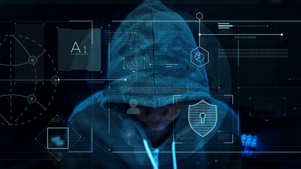 A person wearing a hooded sweatshirt. Computer coding and symbols are over the top of the figure