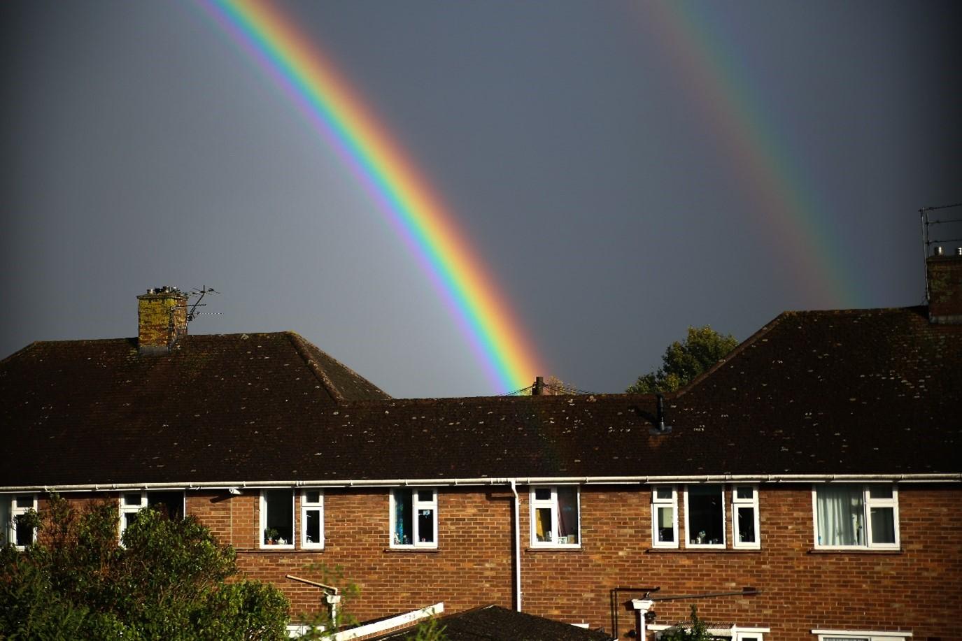 a double rainbow over a row of houses