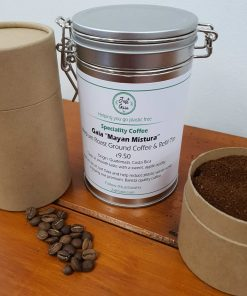 "South American speciality coffee ""Mayan Mistura"" on display at Just Gaia Halifax, showcasing tins and paper pots for the fresh beans and ground coffee options. All plastic free."