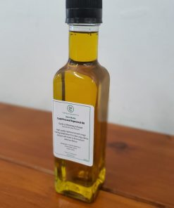 Our Just Gaia cold pressed oils. Zero waste rapeseed oil infused with rosemary and garlic in a glass bottle.