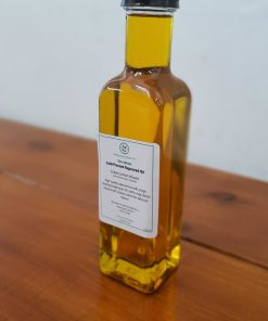 Our Just Gaia cold pressed oils. Zero waste rapeseed oil infused with sicilian lemon in a glass bottle.