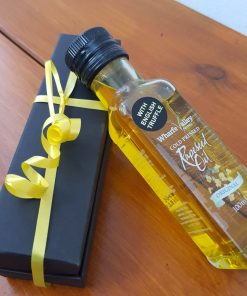 English truffel rapeseed oil resting next to its gift box at Just Gaia plastic free shop