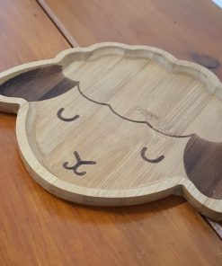 Bamboo children's plates (Lamb shape) on display in Just Gaia Halifax.
