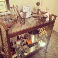 the bar cart stocked with gifts from family and friends