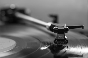 Detailed image showing a turntable cartridge installed on a turntable with a record below.