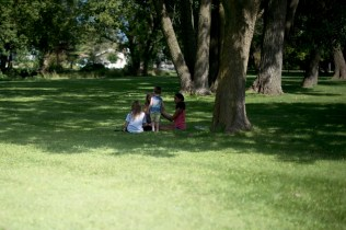 "This was the best part of the day. He shyly inched his way over to three young teenage girls sitting by a cluster of trees. He was too shy to walk right up, so he slowly approached them, only to arrive a few feet away and throw handfulls of grass toward them. They thought he was sweet and started asking him questions... like ""what's your favorite color?"". I was suddenly not even ""in the room."""