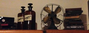 header image is of old books, old bottles, and an old fan.