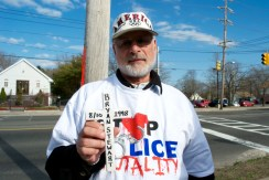 Long Island Protester Bob, holds a cross for police brutality victim, Bryan Stewart, Annual Anti-Police Brutality March in Long Island, NY, Bay Shore, April 13th, 2013.