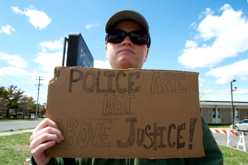 A Long Island Protester holds a sign. Annual Anti-Police Brutality March in Long Island, NY, Bay Shore, April 13th, 2013.