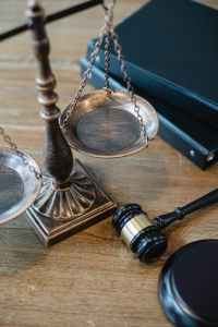 symbols of justice and law on table of judge