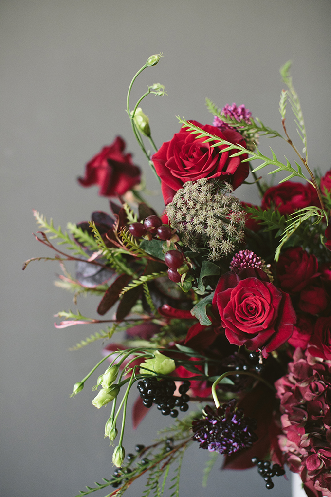Luxe Holiday Floral Inspiration | Moody Winter Flower Arrangement with Black Magic Roses, Black Baccara Roses Gem and Lace Spray Garden Roses, Liqustrom, Hypericum, Allium, Lisianthus, Scabiosa, Chocolate Lace, Cotinus, Photina and Grevillea by Rebecca Dawn Design // JustineCelina.com