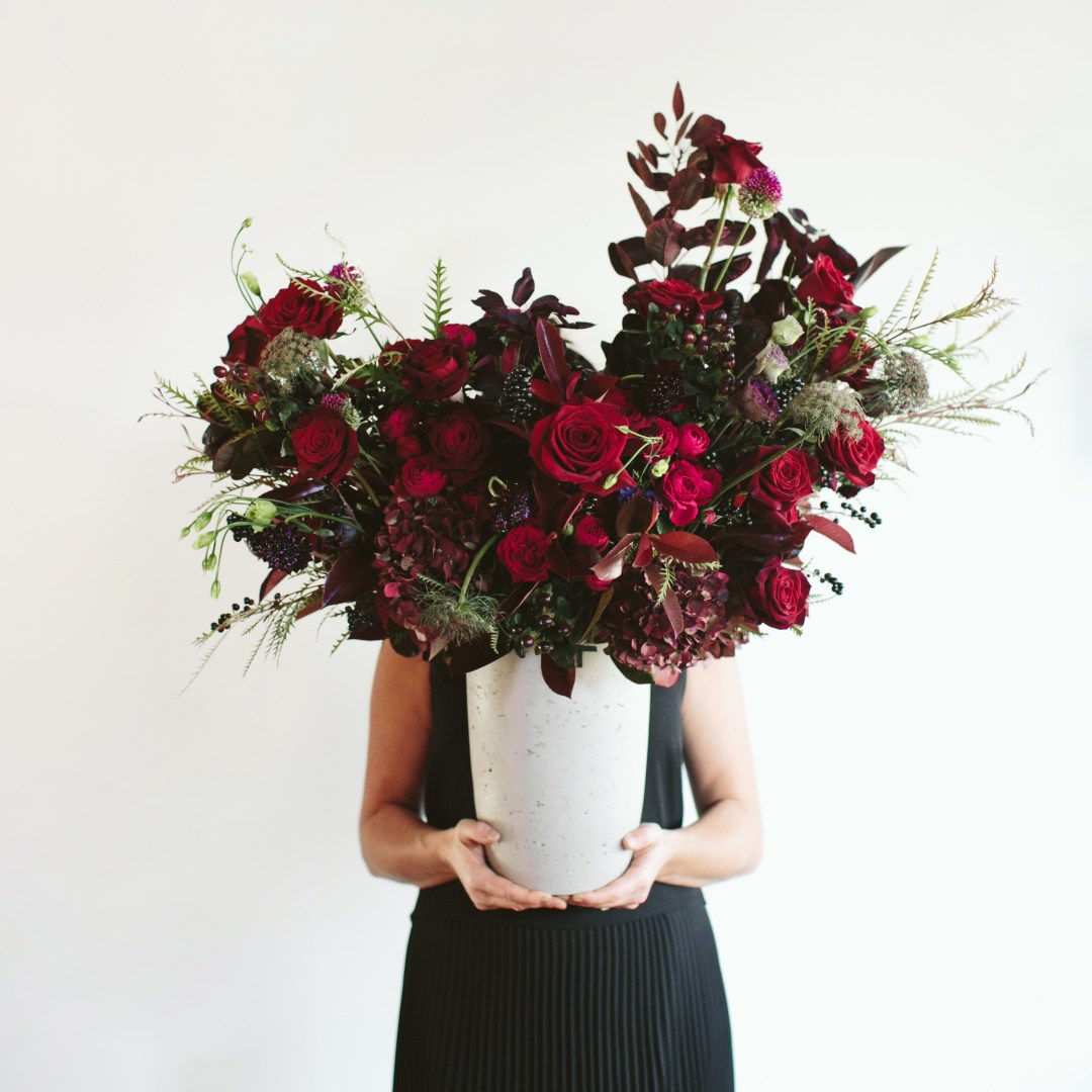 Luxe Holiday Floral Inspiration | Moody Winter Flower Arrangement with Black MagicRoses, Black Baccara Roses Gem and Lace Spray Garden Roses, Liqustrom, Hypericum, Allium, Lisianthus, Scabiosa, Chocolate Lace, Cotinus, Photina and Grevillea by Rebecca Dawn Design // JustineCelina.com