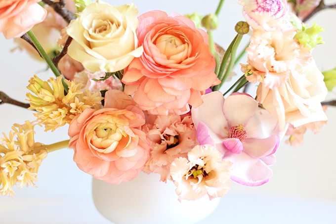 A Blushing Spring Arrangement with Coral Japanese Ranunculus, Lisianthus, Hyancith, Magnolia and Quicksand Roses | Spring Wedding Flower Ideas | Pantone Colour Trends Spring 2017 // JustineCelina.com
