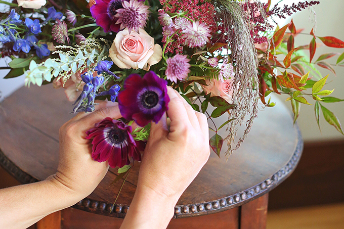 A PANTONE 2018 Ultra Violet Inspired Arrangement with Anemones, Spray Roses, Bella Donna, Dephinium, Astrantia, Astilbe, Sedum, Ruby Silk Grass, Nandina, Umbrella Fern and Knife blade Acacia | Step by Step Flower Arranging Guide // JustineCelina.com x Rebecca Dawn Design