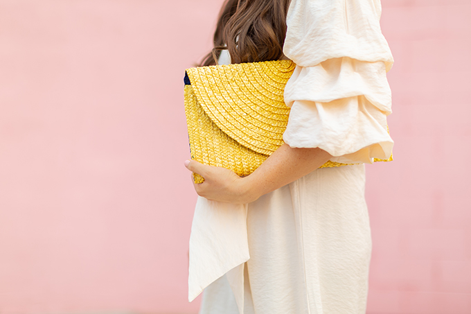 The Accessory Edit   Natural Material Bags   Yellow Straw Clutch   How to Style Oversized Straw Clutches   The Best Straw Bags 2018 // JustineCelina.com