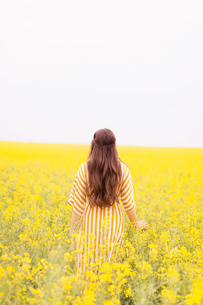Pattern Play | Stripes | How to Style Stripes for Summer 2018 | The Best Striped Dresses 2018 | Mustard Striped Button Down Dress | Woman in a field of Canola | Calgary Fashion Blogger | Canadian Fashion Blogger // JustineCelina.com