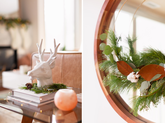 Apartment Friendly Modern Holiday Decor | White Reindeer Head Sculpture with with added greenery and fairy lights | DIY Modern Holiday Wreath with Magnolia Leaves, Cotton, Silver Dollar Eucalyptus, Seeded Eucalyptus, Cedar and Insense Cedar | Bohemian, Mid Century Modern Holiday Decor | Bohemian Holiday Home Tour 2018 | Caramel Mid Century Modern Leather Couches | Canadian Tire CANVAS Ornaments // JustineCelina.com
