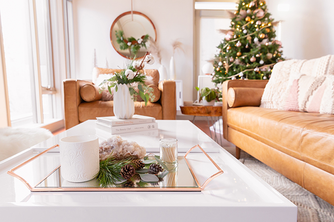 Apartment Friendly Modern Holiday Decor | Simple Holiday Coffee Table with Candles, Quartz, Fresh Greenery and Pinecones | Simple Holiday Arrangement on a Coffee Table with Greenery and Cotton Stems | Bohemian, Mid Century Modern Holiday Decor | Bohemian Holiday Home Tour 2018 | Canadian Tire CANVAS Ornaments // JustineCelina.com